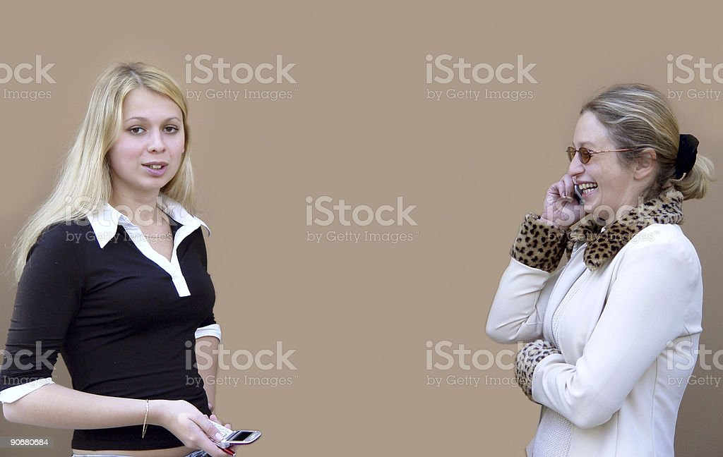 Blond women with phones royalty-free stock photo