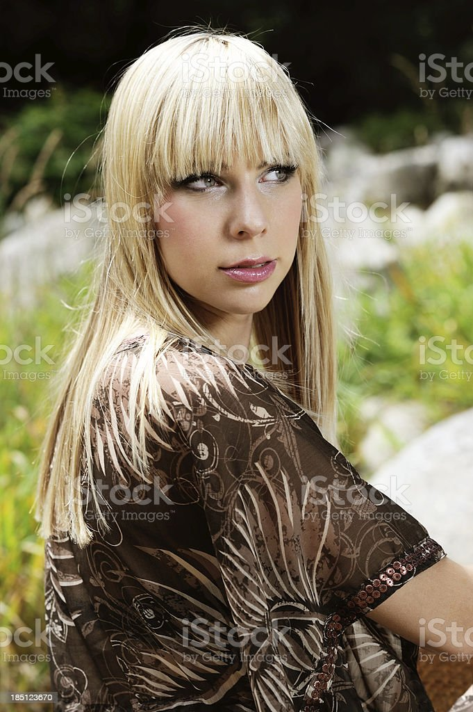 Blond young Woman brown Tunic Summer Portrait royalty-free stock photo