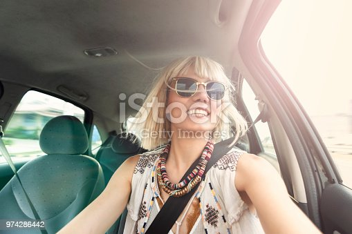 832085296 istock photo Blond young woman in a road trip 974286442