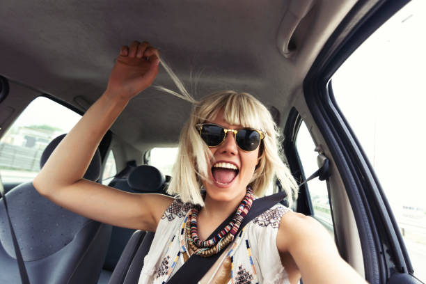 Blond young woman in a road trip stock photo