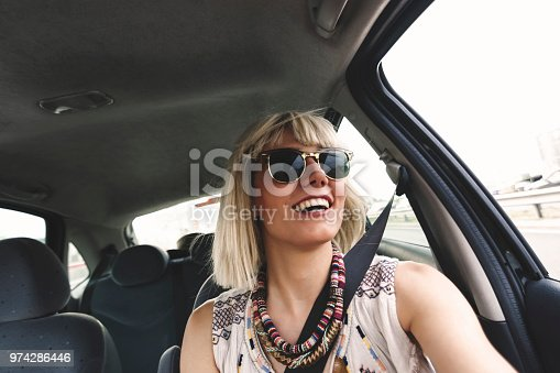 832085296 istock photo Blond young woman in a road trip 974286446
