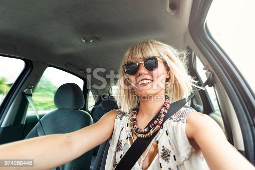 832085296 istock photo Blond young woman in a road trip 974286448