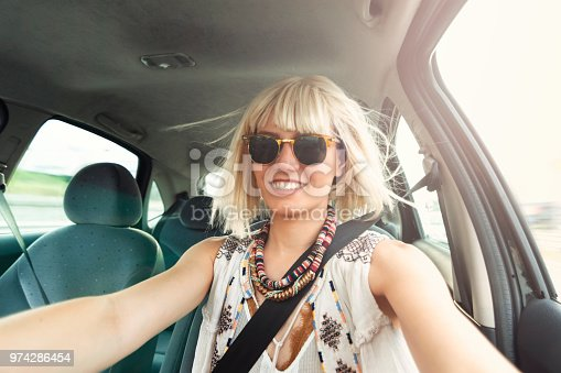 832085296 istock photo Blond young woman in a road trip 974286454
