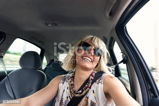 832085296 istock photo Blond young woman in a road trip 975204592