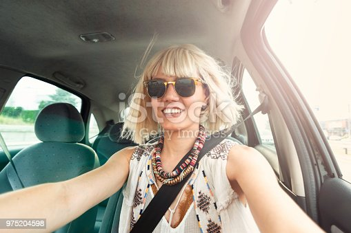 832085296 istock photo Blond young woman in a road trip 975204598