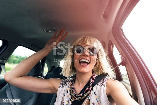 832085296 istock photo Blond young woman in a road trip 975204606