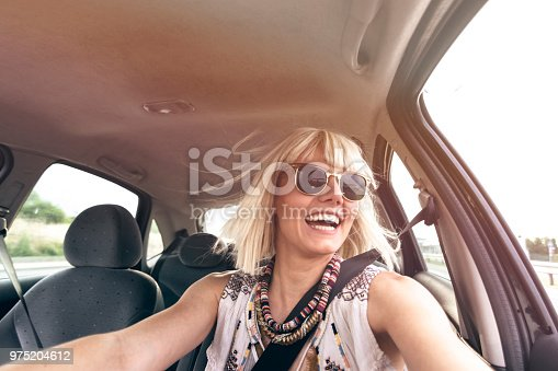 832085296 istock photo Blond young woman in a road trip 975204612