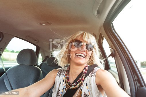 832085296 istock photo Blond young woman in a road trip 978277848