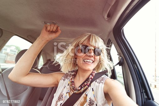 832085296 istock photo Blond young woman in a road trip 978277852