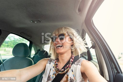 832085296 istock photo Blond young woman in a road trip 978277856
