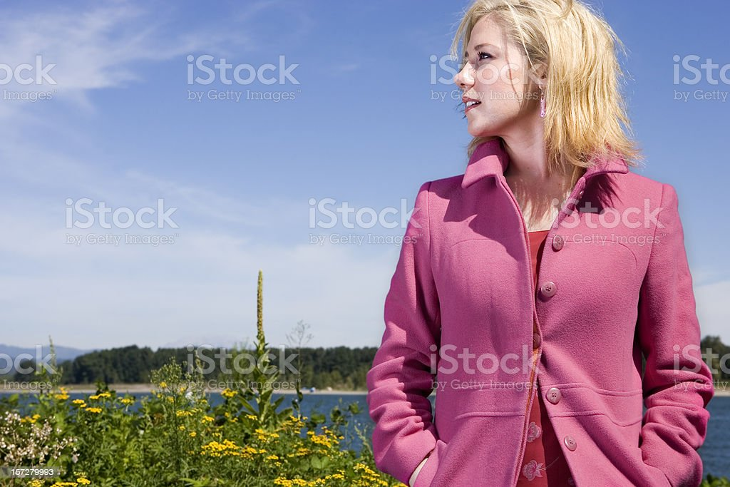 Blond Young Woman in Field with Sunny Sky, Copy Space stock photo
