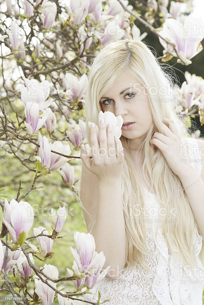 Blond young Woman with Magnolia Blossoms Spring royalty-free stock photo