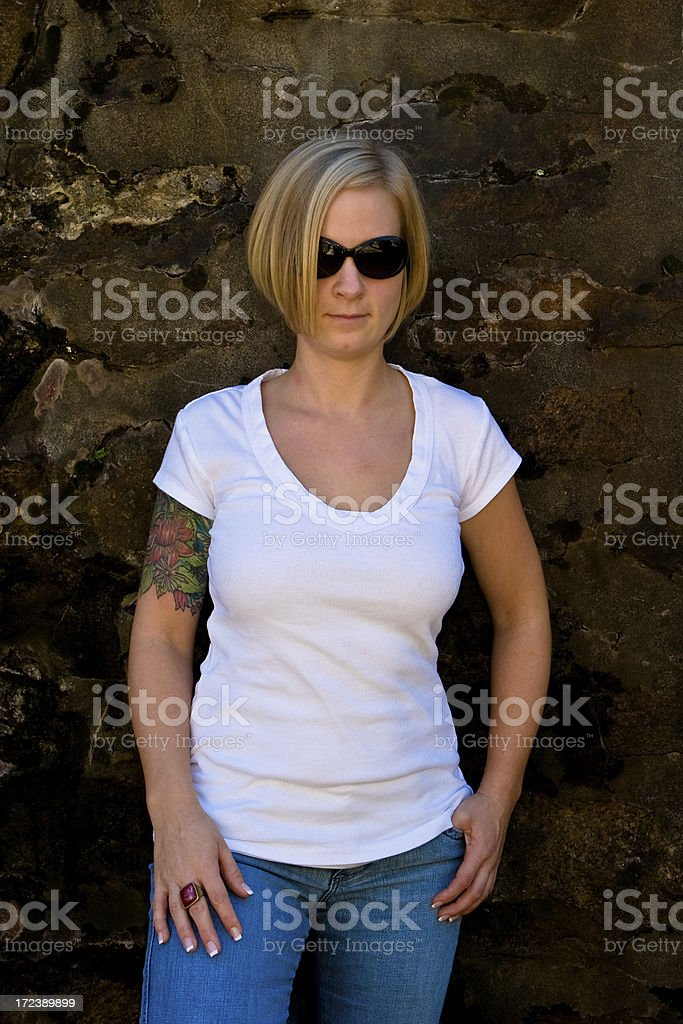 blonde against stone wall royalty-free stock photo