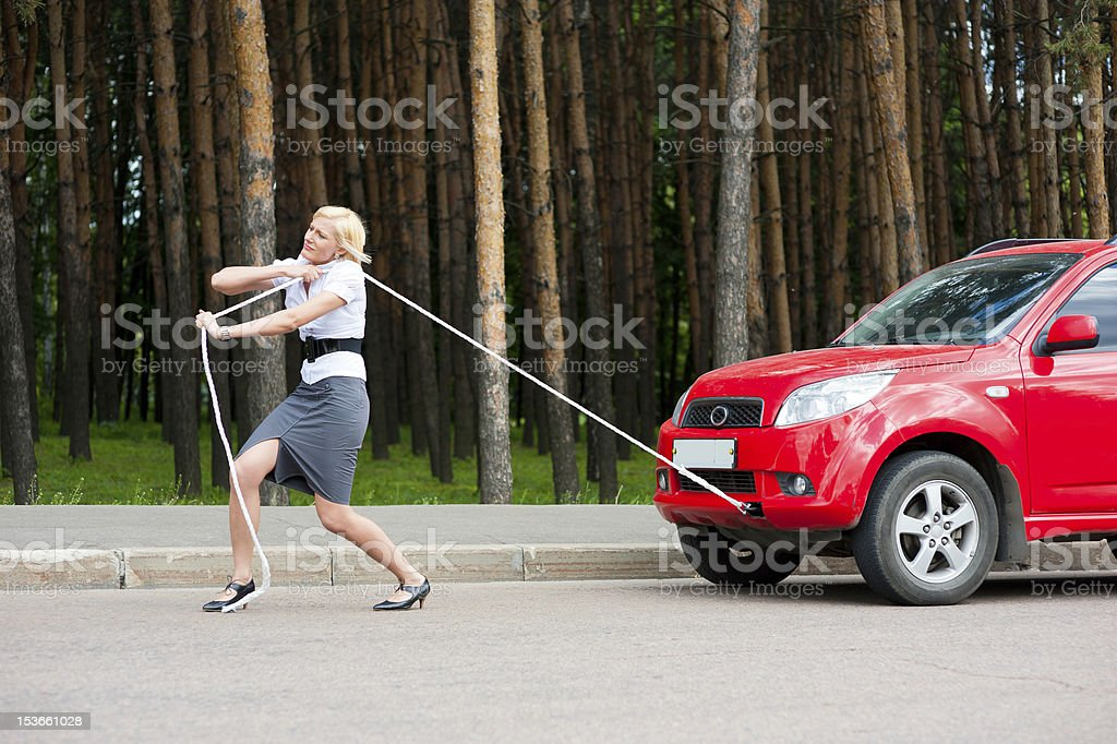 Blonde and broken car royalty-free stock photo