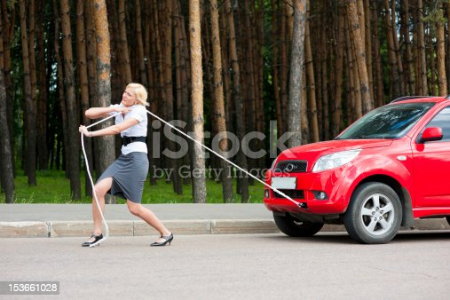 istock Blonde and broken car 153661028