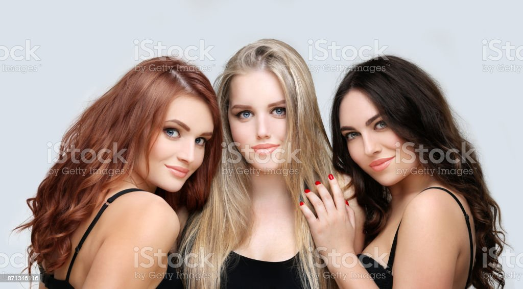 Blonde and brunette.Concept Coloring Hair stock photo