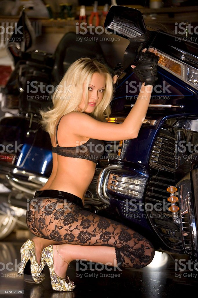 Blonde and motorcycle royalty-free stock photo