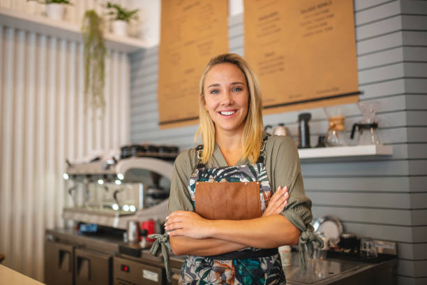 Blonde Argentine Barista Looking at Camera and Smiling stock photo