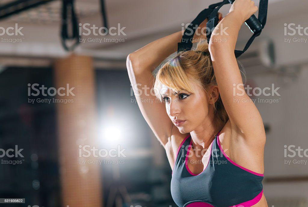 Blonde Athlete Doing Suspension Exercises For Arms And Shoulders