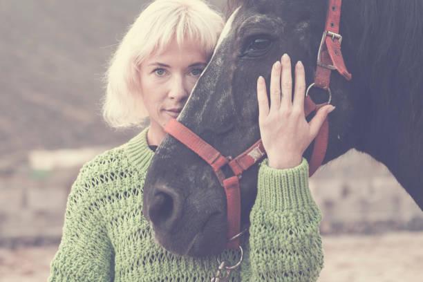 Blonde beautiful caucasian model woman with black amazing horse stay picture id1139281485?b=1&k=6&m=1139281485&s=612x612&w=0&h=dstvkvc890ramxqxnjsutynqyjmcoqx6slmcjzmas y=