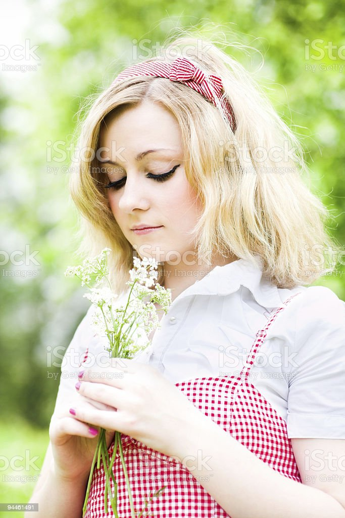 Blonde beautiful girl portrait with flowers royalty-free stock photo