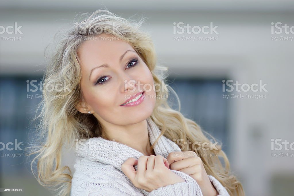 Blonde beautiful happy woman smiling stock photo