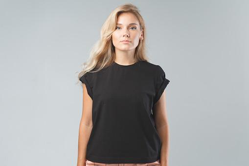 Blonde beautiful woman in black T-Shirt. Studio shoot