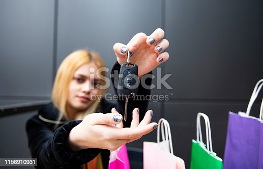 blonde beautiful woman is handing car key
