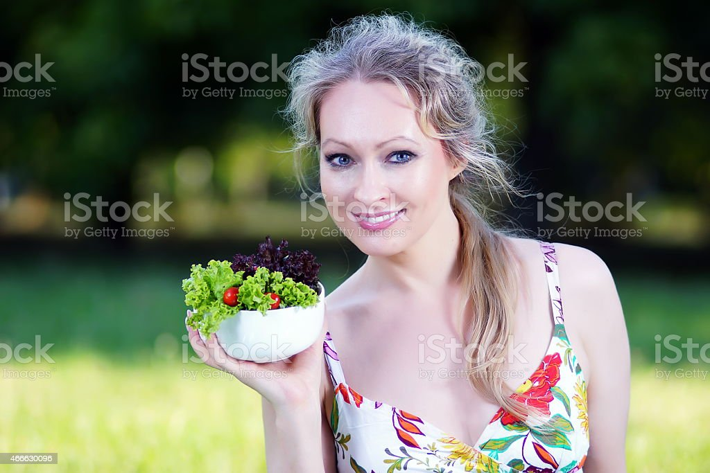 Blonde beauty with salad stock photo
