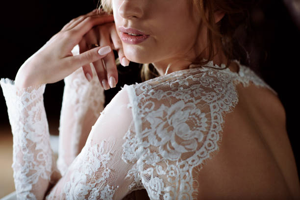 Blonde bride in fashion white wedding dress with makeup stock photo