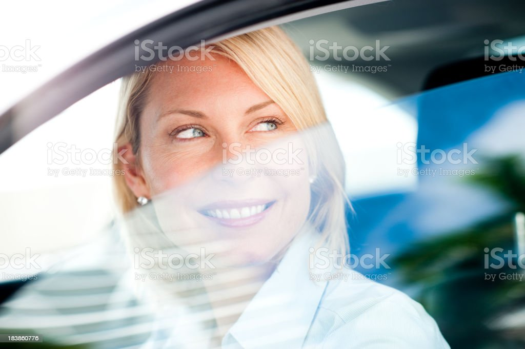 Blonde Business Woman Driving Car royalty-free stock photo