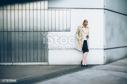 Blonde Businesswoman Checking Her Emails On Smart Phone Stock Photo & More Pictures of 2015