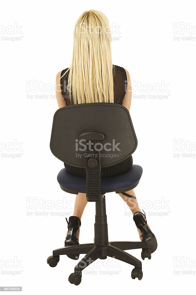 Blonde businesswoman in black on office chair royalty-free stock photo