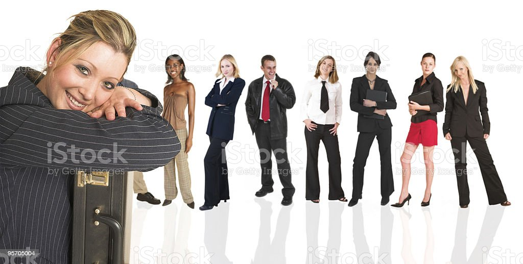 Blonde businesswoman standing in front of a business people group royalty-free stock photo