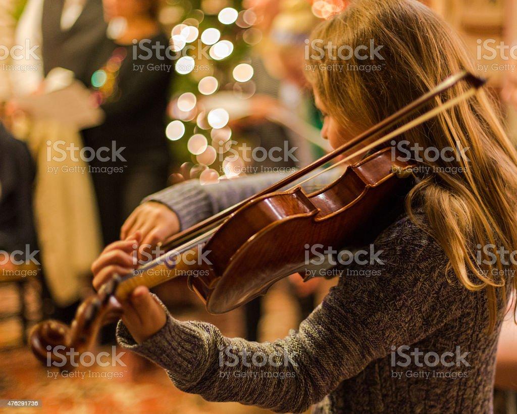 Blonde Christmas Fiddler stock photo