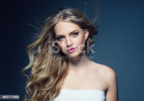 Blonde curly hair woman young female model with pink lips and beautiful beauty hairstyle. Studio shot.