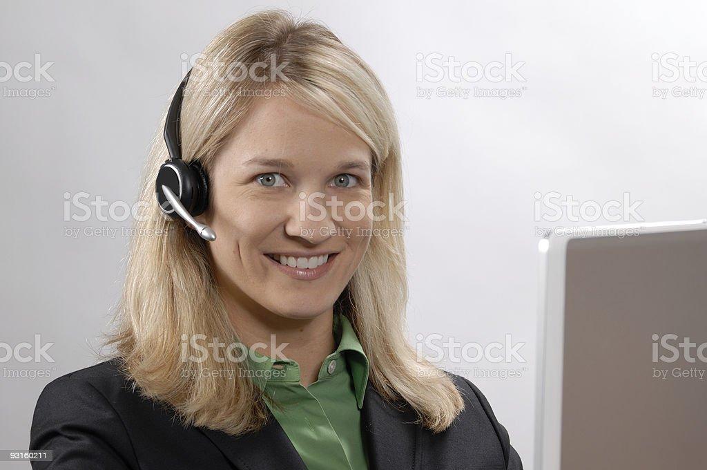 Blonde Customer Service Rep headset computer stock photo
