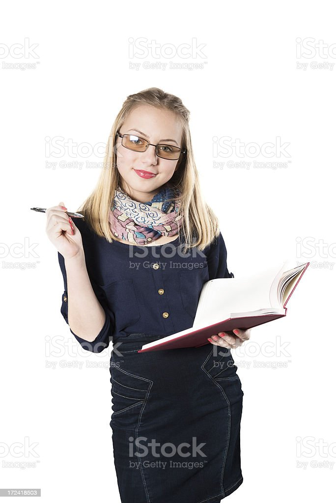 Blonde Cute Girl with Glasses Writing on Notebook royalty-free stock photo