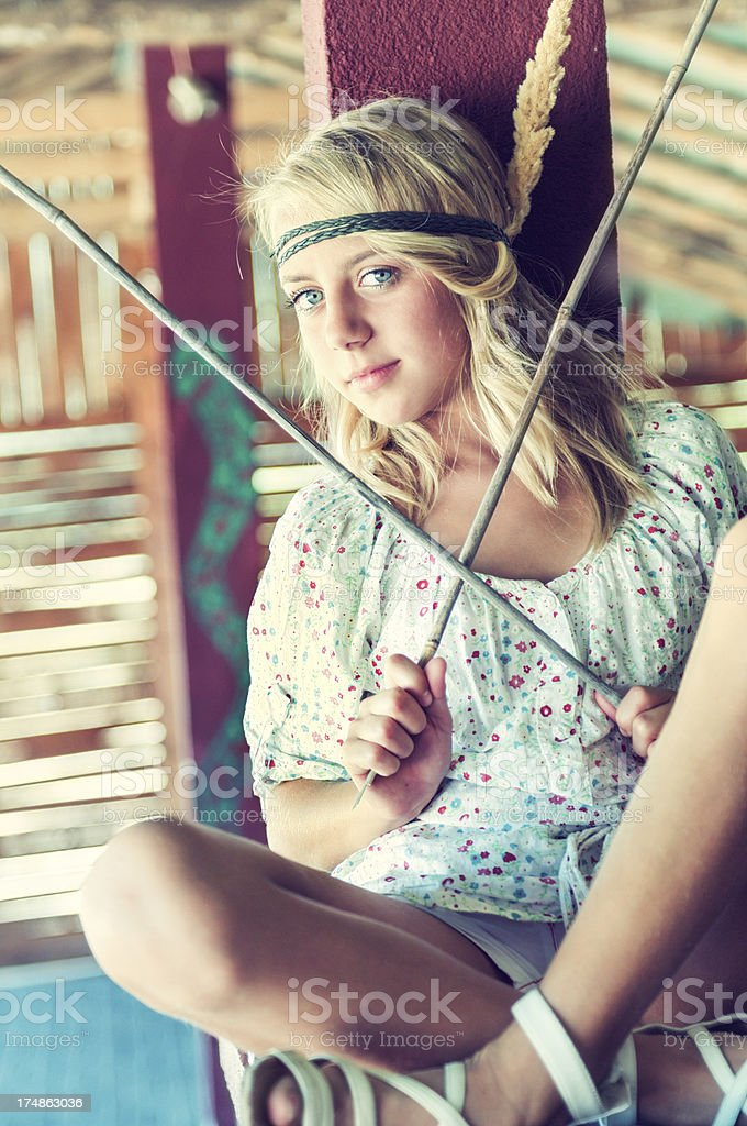 Blonde Cute Little Girl With Blue Eyes Posing stock photo