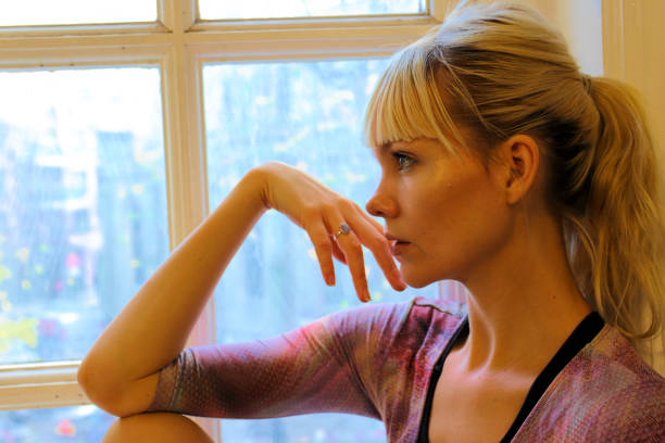 blonde danish ballerina thoughtful profile in old window london - whiteway danish stock photos and pictures