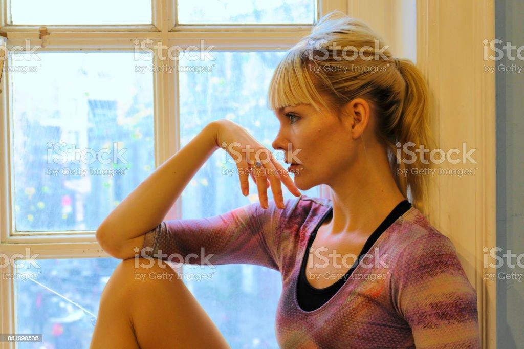 Blonde Danish ballerina thoughtful profile in old window London stock photo