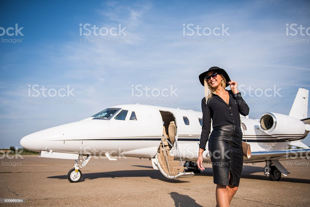 Blonde elegant woman leaving airport track stock photo