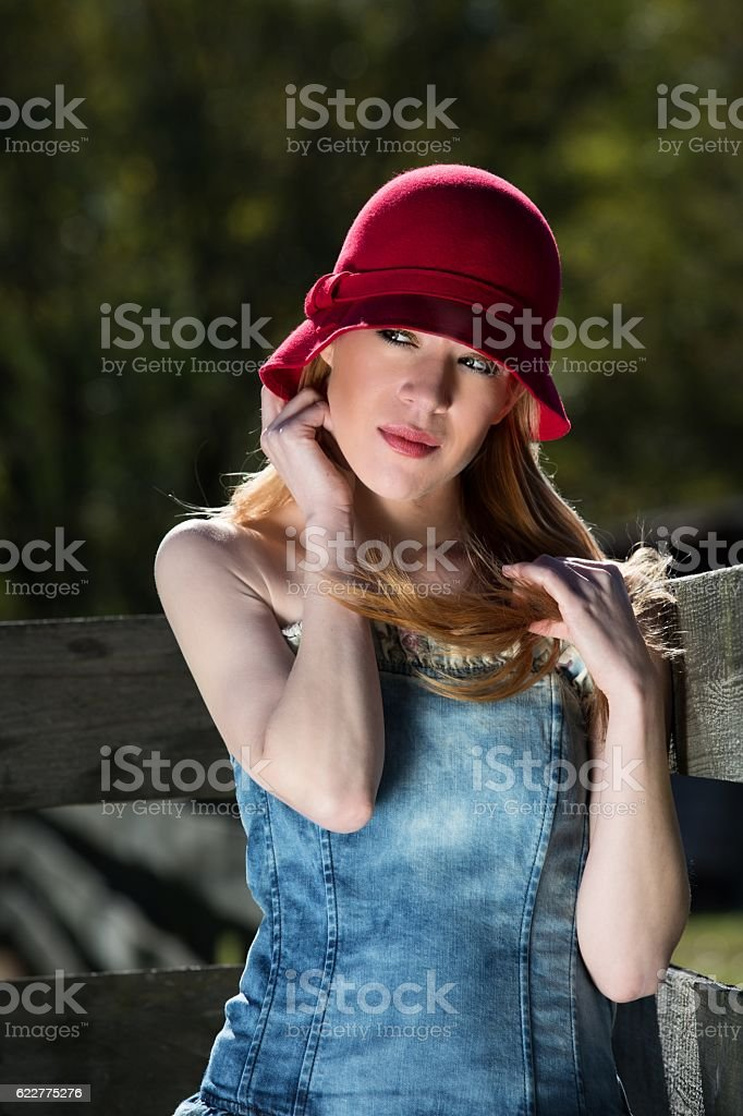 Blonde Female in Red Hat stock photo
