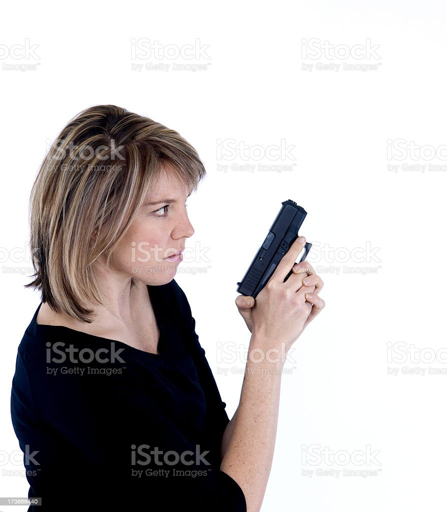 Blonde female on guard with handgun stock photo
