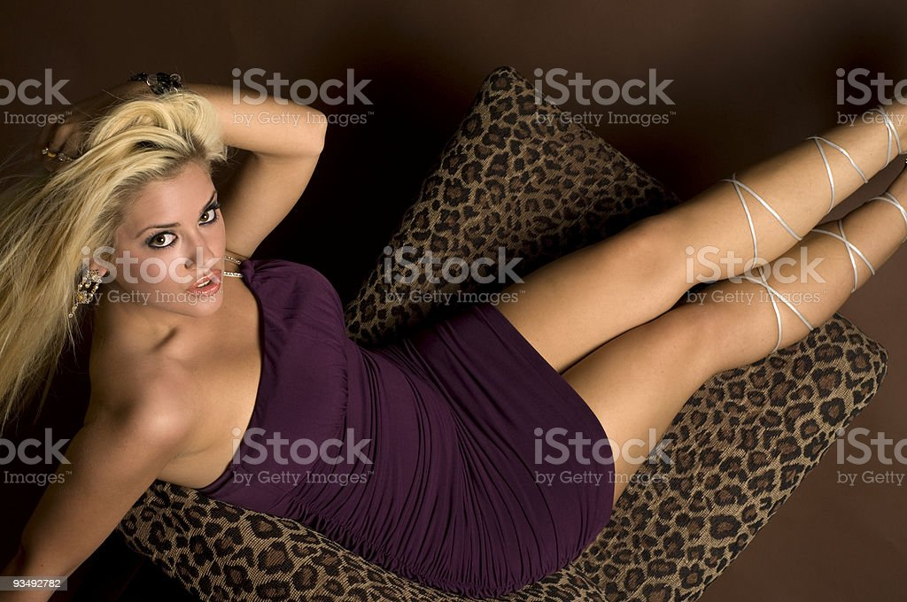Blonde Female Pinup Model In A Purple Dress stock photo