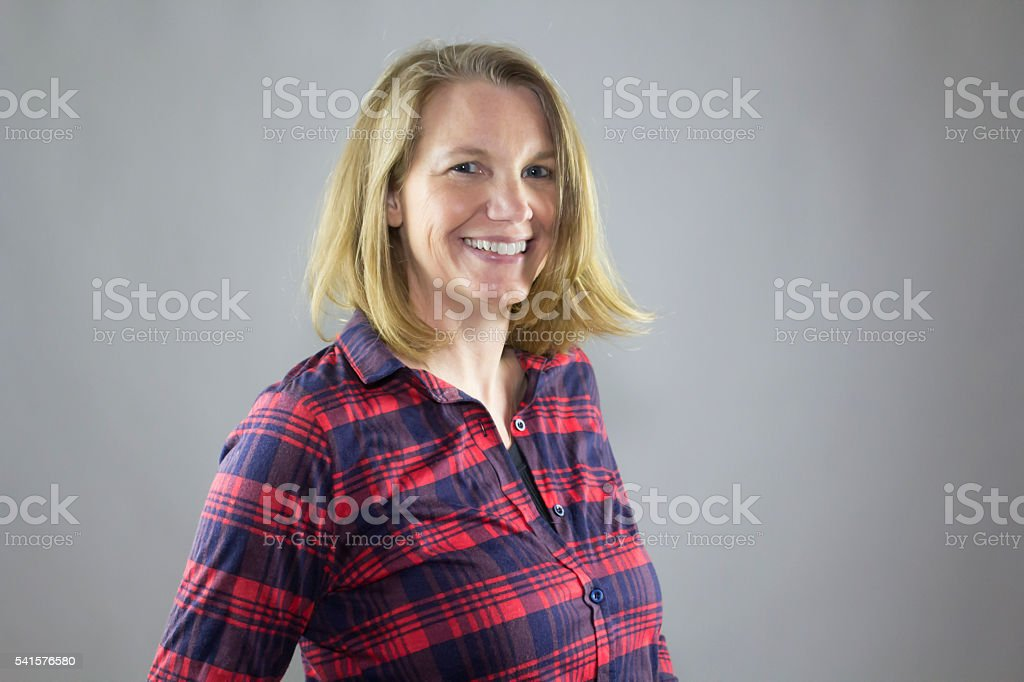 Blonde Female Smiling Red Shirt stock photo