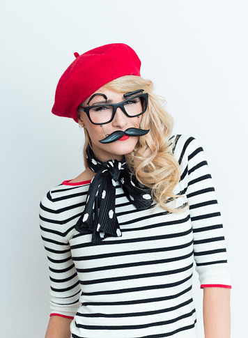 Blonde French Woman Wearing Red Beret And Facial Mask Stock Photo - Download Image Now