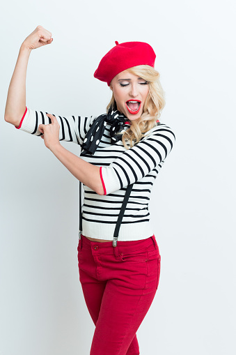 Blonde French Woman Wearing Red Beret Flexing Her Bicep Stock Photo - Download Image Now