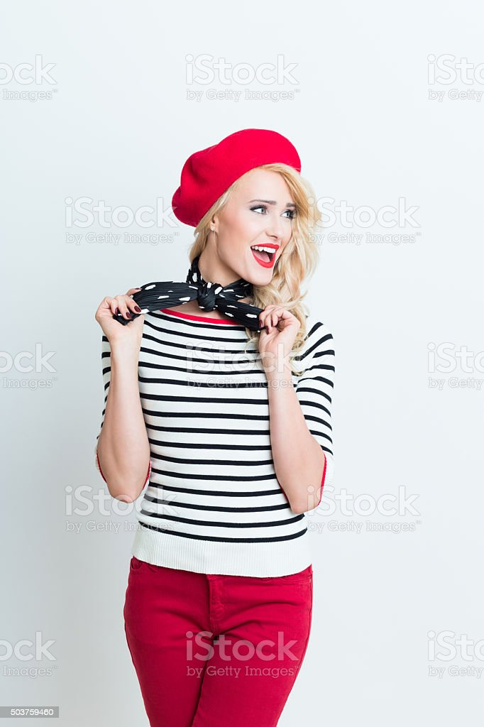 Blonde french woman wearing red beret Portrait of beautiful blonde woman in french outfit, wearing a red beret, striped blouse and neckerchief. Adult Stock Photo