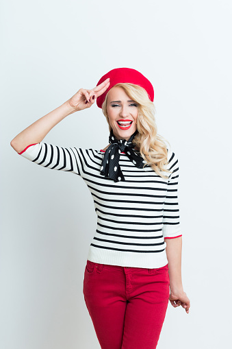 Blonde French Woman Wearing Red Beret Saluting Stock Photo - Download Image Now